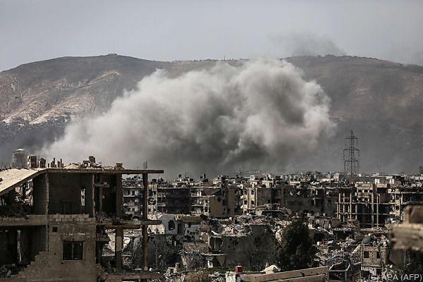 In Damaskus steigt Rauch auf